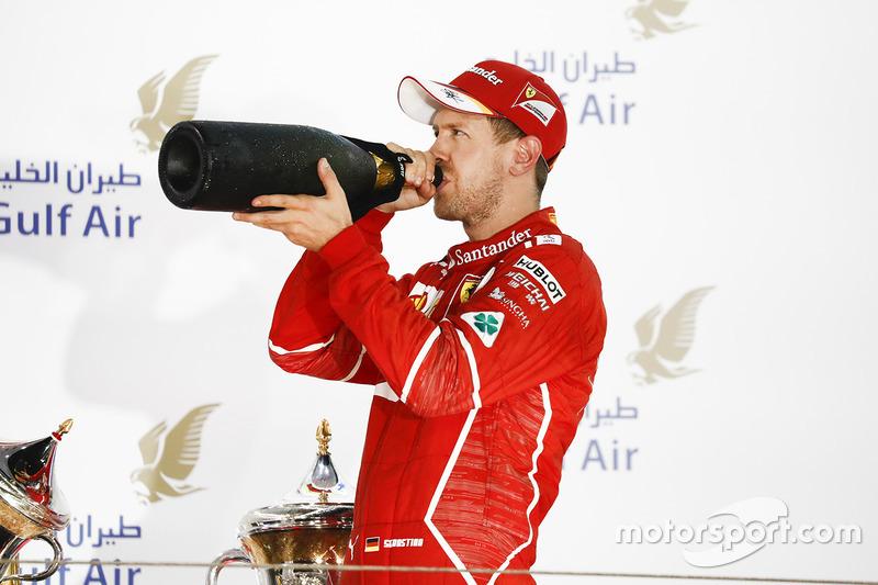 Podium: race winner Sebastian Vettel, Ferrari drinks Rose Water