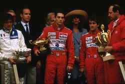 Ayrton Senna, McLaren Honda, 1st position, Alain Prost, McLaren Honda, 2nd position and Stefano Modena, Brabham BT58 Judd, 3rd position celebrate on the podium. McLaren team boss Ron Dennis on the far right