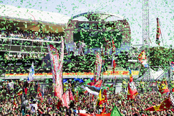 Confetti falls as Race winner Lewis Hamilton, Mercedes AMG F1, Second place Third place Valtteri Bottas, Mercedes AMG F1 Sebastian Vettel, Ferrari, celebrate on the podium