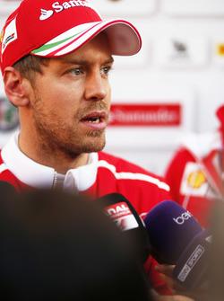 Sebastian Vettel, Ferrari, talks to the media