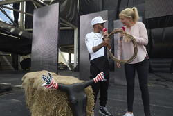 Lewis Hamilton, Mercedes AMG F1, is given a lasso on stage