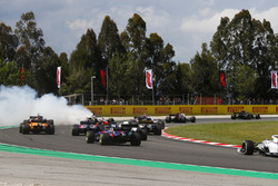 Romain Grosjean, Haas F1 Team VF-18, spins in the pack, causing an accident involving by collecting Nico Hulkenberg, Renault Sport F1 Team R.S. 18, and Pierre Gasly, Toro Rosso STR13