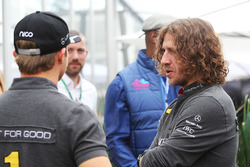 (L to R): Nico Rosberg, Mercedes AMG F1 with Carles Puyol, Retired Football Player