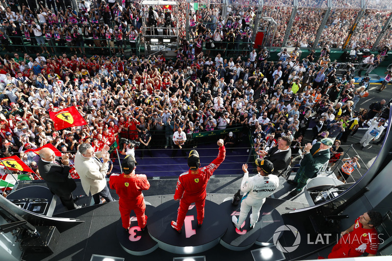Race winner Sebastian Vettel, Ferrari, second place Lewis Hamilton, Mercedes AMG F1, third place, Ki