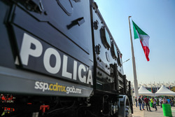 Police and Mexican flag