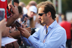 Jarno Trulli, signs autographs for the fans