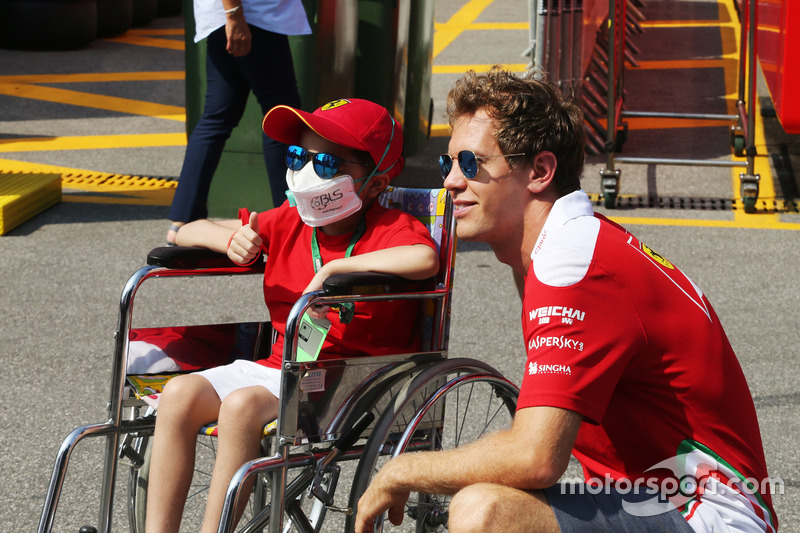 Sebastian Vettel, Ferrari with a young fan