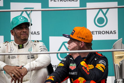 Lewis Hamilton, Mercedes AMG F1 and Max Verstappen, Red Bull Racing celebrates on the podium