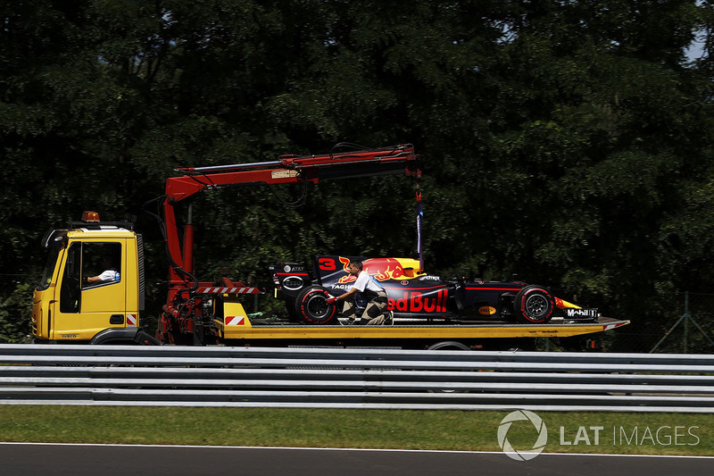 The Daniel Ricciardo Red Bull Racing RB13 is returned to the pits on a truck