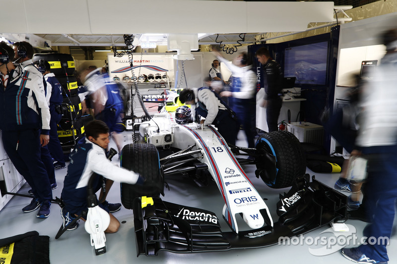 Lance Stroll, Williams FW40, in the Williams garage
