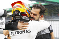 Lewis Hamilton, Mercedes AMG F1, celebrates, Marc Hynes after taking his 69th F1 Pole Position