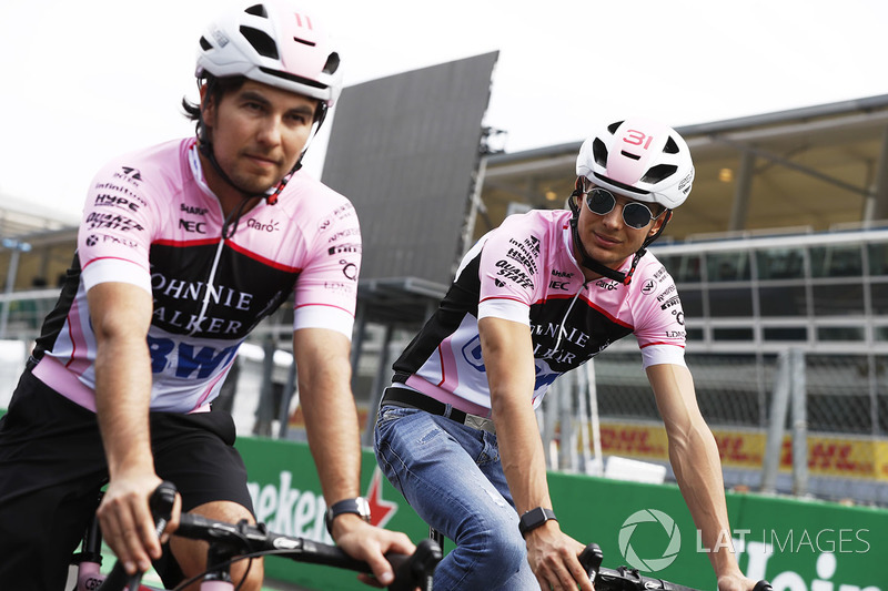 Esteban Ocon, Force India, Sergio Perez, Force India, take to the circuit on bicycles