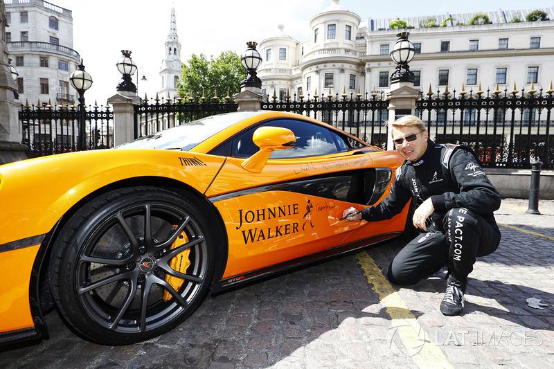 Former 2 times World Champion Mika Hakkinen, signs a special McLaren MP4-12C