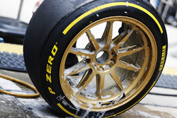 A Lotus team member works on the 18 inch wheels