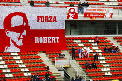 Fans of Robert Kubica, Williams, display a banner