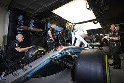 Lewis Hamilton, Mercedes AMG F1, climbs in to his car