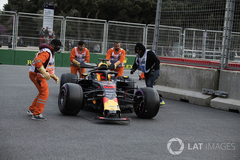 The carshed car of Daniel Ricciardo, Red Bull Racing RB14 is recovered