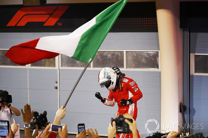 Sebastian Vettel, Ferrari, celebrates with his team after winning the race