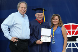 Cole Custer, Haas Racing Development Chevrolet with his parents after graduating High School