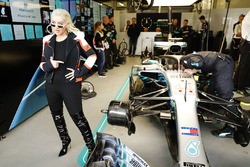 Christina Aguilera poses for a photo with the car of Lewis Hamilton, Mercedes AMG F1 W09