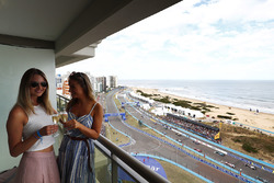 Guests with a glass of champagne as the race starts