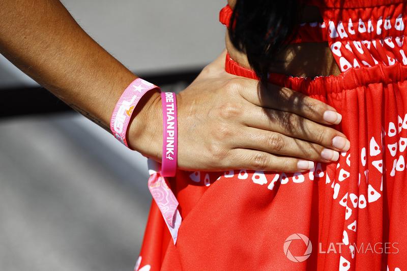 Grid girl with Think Pink bracelet