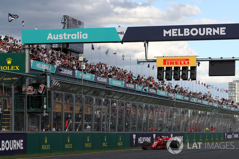 Race winner Sebastian Vettel, Ferrari SF71H crosses the line and takes the chequered flag