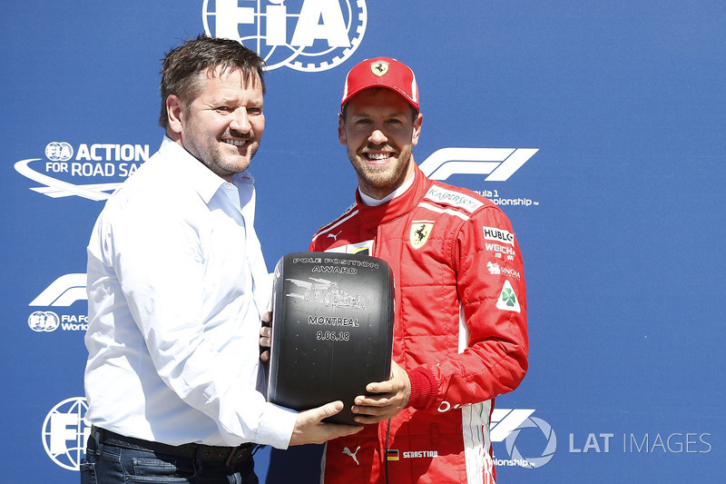 Sebastian Vettel, Ferrari receives the Pirelli Pole Position award from Paul Hembery, Pirelli Motorsport Director