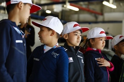 Young fans in a garage