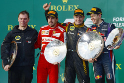 Podium: Alan Permane, Lotus F1 Team Race Engineer, second place Fernando Alonso, Ferrari, race winner Kimi Raikkonen, Lotus F1 Team, third place Sebastian Vettel, Red Bull Racing