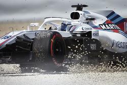 Lance Stroll, Williams FW41, runs through the gravel