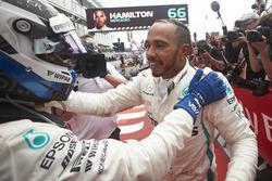 Valtteri Bottas, Mercedes AMG F1, and Race winner Lewis Hamilton, Mercedes AMG F1, celebrate in Parc Ferme