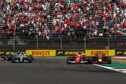 Max Verstappen, Red Bull Racing RB13 and Sebastian Vettel, Ferrari SF70H battle and collide at the start of the race