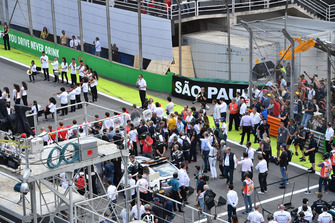 Drivers during the National Anthem on the grid
