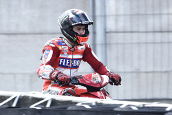 Jorge Lorenzo, Ducati Team on a scooter riding back to the pits after crashing