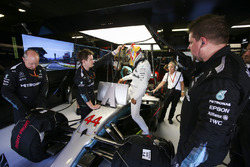 Lewis Hamilton, Mercedes AMG F1, climbs in to his car in the garage, prior to heading to the front of the grid