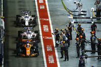 Fernando Alonso, McLaren MCL32, Lance Stroll, Williams FW40, Romain Grosjean, Haas F1 Team VF-17, through the pit lane