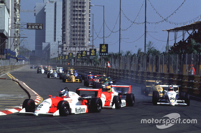 Mika Hakkinen leads Eddie Irvine and Michael Schumacher at the start of the race