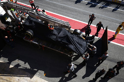The McLaren MCL32 of Fernando Alonso is returned to the pits on a truck