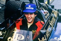 Ayrton Senna, Lotus 97T-Renault, sits in teammates Elio de Angelis car in the pits