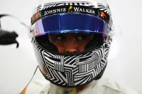 Fernando Alonso, McLaren, sports a new helmet design