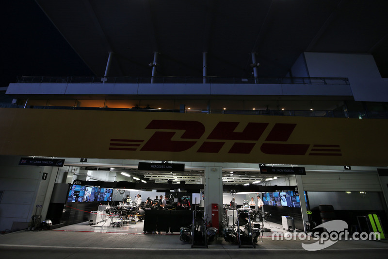 The Mercedes AMG F1 pit garages at night