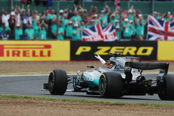 Lewis Hamilton, Mercedes AMG F1 W08, waves to the crowd after victory