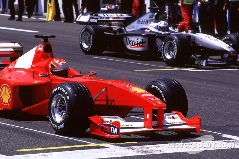 Michael Schumacher, Ferrari and David Coulthard, McLaren