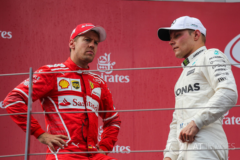 Podium: race winner Valtteri Bottas, Mercedes AMG F1, second place Sebastian Vettel