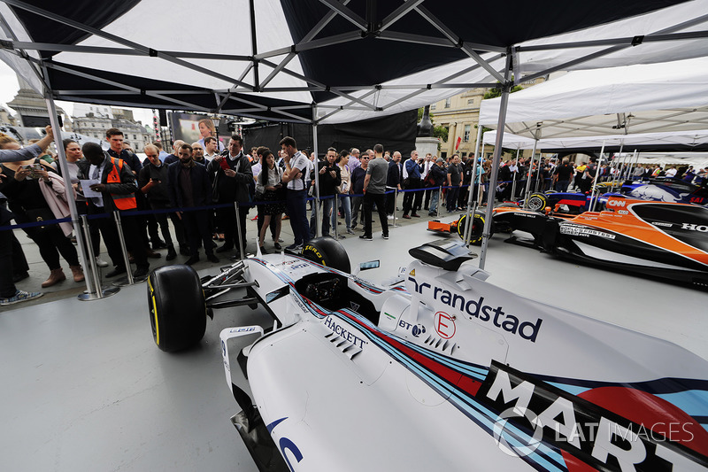 The Williams FW40 is inspected and photographed by fans on the teams stand