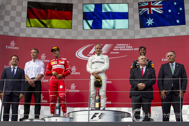 Podium: race winner Valtteri Bottas, Mercedes AMG F1, second place Sebastian Vettel, Ferrari, third