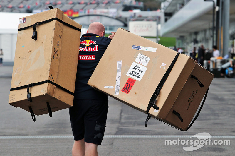 Red Bull Racing mechanic with boxes