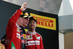 The podium, Ferrari, second; Max Verstappen, Red Bull Racing, race winner; Sebastian Vettel, Ferrari, third