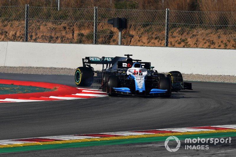 Robert Kubica, Williams FW42 and Lewis Hamilton, Mercedes-AMG F1 W10